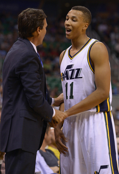 Leah Hogsten  |  The Salt Lake Tribune Utah Jazz guard Dante Exum (11) reacts to Utah Jazz head coach Quin Snyder's words as he comes off the court. Utah Jazz defeated the Portland Blazers 92-73 during Tuesday's, October 7, 2014 preseason opener at Energy Solutions Arena.