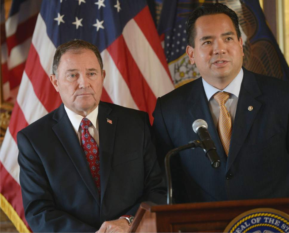 Al Hartmann  |  The Salt Lake Tribune Utah Governor Gary Herbert, left, and Utah Attorney General Sean Reyes speak at press conference at the state capitol Monday October 6 regarding the U.S. Supreme Court's decision not to hear the state's argument in it's defense of marriage law which now opens the door for same sex marriage in the state of Utah and other states.