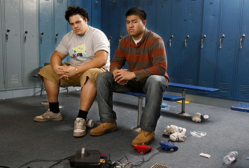 South Jordan - Bingham High School football players Derek Tuimauga (left) and Iona Pritchard are cousins who are going to play for in-state rivals BYU (Pritchard) and the University of Utah (Tuimauga). They were photographed in locker room at Bingham,Thursday, January 24, 2008. Trent Nelson/The Salt Lake Tribune; 1.24.2008