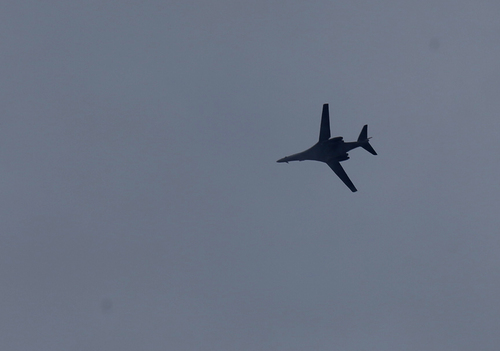 A fighter aircraft of the US-led coalition flies over Mursitpinar in the outskirts of Suruc, at the Turkey-Syria border, as it approaches Syria to deliver an airstrike in Kobani, during fighting between Syrian Kurds and the militants of Islamic State group, Thursday, Oct. 16, 2014. Kobani, also known as Ayn Arab, and its surrounding areas, has been under assault by extremists of the Islamic State group since mid-September and is being defended by Kurdish fighters. (AP Photo/Lefteris Pitarakis)