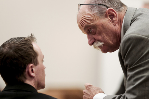 Spencer Heaps  |  Pool   Conrad Truman, left, talks to his defense attorney, Ron Yengich, during Truman's trial at 4th District Court in Provo on Thursday, Oct. 9, 2014.  Truman has been charged with murder and obstruction of justice in the 2012 death of his wife, Heidy Truman.