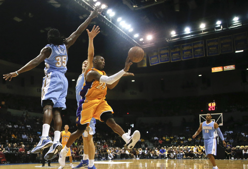 Los Angeles Lakers guard Kobe Bryant fires an outlet pass while splitting the defense of Denver Nuggets forward Kenneth Faried, left, and center Timofey Mozgov during the first half of a NBA preseason basketball game  Monday, Oct. 6, 2014, in San Diego. (AP Photo/Lenny Ignelzi