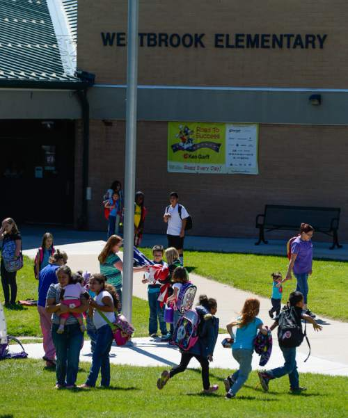 Francisco Kjolseth  |  The Salt Lake Tribune Westbrook Elementary in Taylorsville lets out for the day on Friday afternoon following an incident the day before where 6th-grade teacher Michelle Ferguson- Montgomery, accidentally discharged her handgun in a school restroom.