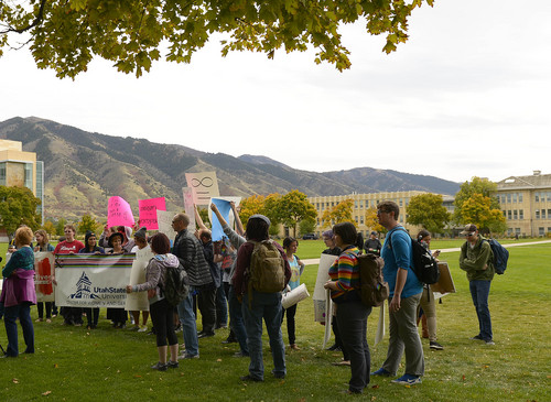 Leah Hogsten  |  The Salt Lake Tribune Utah State University students and faculty rallied in support of feminist writer Anita Sarkeesian, who was supposed to address the campus until an author of an email threatened bloody mayhem on the campus if she was allowed to speak, Wednesday, October 15, 2014, outside the Glen Taggart Student Center on the campus of Utah State University.  Sarkeesian cancelled her appearance on both the threat -- and a state law that allows conceal-carry permit holders to be armed at events in public venues.