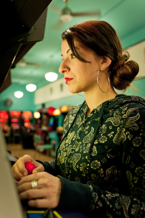Alex Lazara  |  Courtesy Feminist Frequency Anita Sarkeesian at The Rusty Quarters Retro Arcade & Museum in Minneapolis. Sarkeesian canceled her speech scheduled for Wednesday at Utah State University.