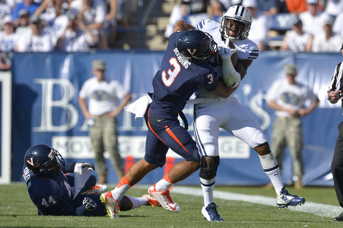 Chris Detrick  |  The Salt Lake Tribune Virginia Cavaliers safety Quin Blanding (3) tackles Brigham Young Cougars running back Jamaal Williams (21) during the second half of the game at LaVell Edwards Stadium Saturday September 20, 2014.  BYU won the game 41-33.