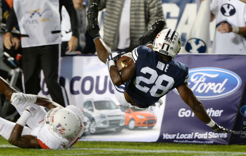 Steve Griffin  |  The Salt Lake Tribune   BYU Cougars running back Adam Hine (28) gets flipped into the air as he runs the ball in the second half of the  game between BYU and Houston and LaVell Edwards Stadium in Provo, Thursday, September 11, 2014.