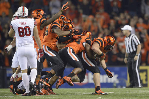 Oregon State defensive end Dylan Wynn (45) celebrates with teammates after intercepting a pass against Utah in an NCAA college football game in Corvallis, Ore., Thursday, Oct. 16, 2014. (AP Photo/Troy Wayrynen)
