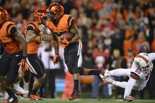 Oregon State kickoff-return specialist Ryan Murphy (25) eludes a Utah tackle during an NCAA college football game in Corvallis, Ore., Thursday, Oct. 16, 2014. (AP Photo/Troy Wayrynen)