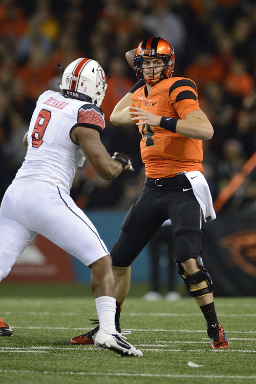 Oregon State quarterback Sean Mannion (4) passes against Utah during the second quarter of an NCAA college football game in Corvallis, Ore., Thursday, Oct. 16, 2014. (AP Photo/Troy Wayrynen)