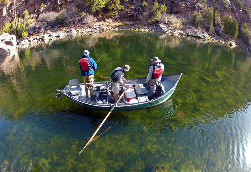 Francisco Kjolseth  |  Tribune file photo One gets a better appreciation for the emerald waters of the Green River when you can get a bird's eye view as a guide navigates two clients down the scenic A section of the river, from Flaming Gorge Dam to Little Hole.