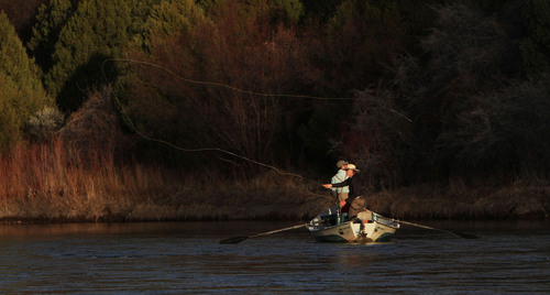 Francisco Kjolseth     Tribune file photo Steve Schmidt, owner of Western Rivers Fly Fisher, casts a line in the setting sun along the Green River, a place where he has been guiding for more than 20 years.