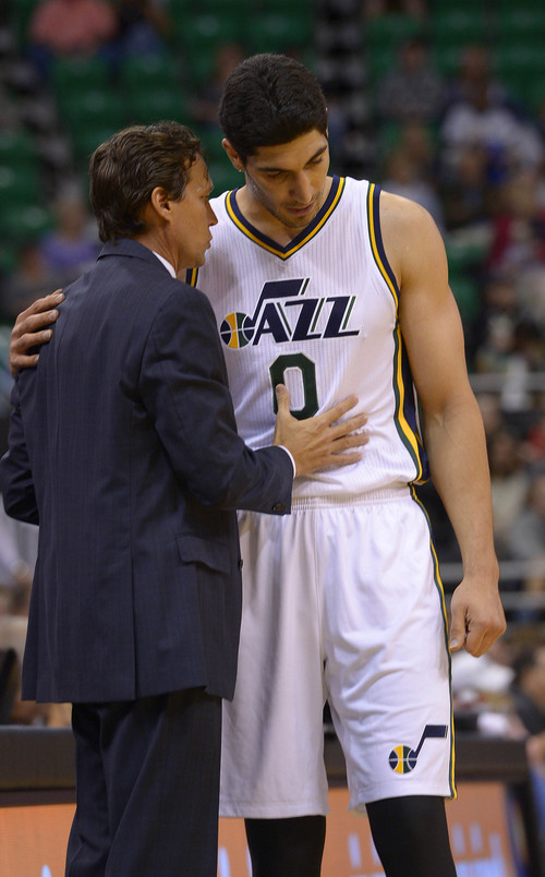 Leah Hogsten     The Salt Lake Tribune Utah Jazz head coach Quin Snyder talks with Utah Jazz center Enes Kanter (0) as he comes off the court during Tuesdays, October 7, 2014 preseason opener at Energy Solutions Arena.