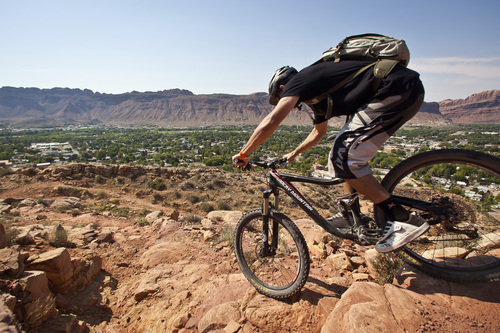 Whit Richardson | A mountain biker check out a new bike on Dave's trail near Moab during the Outerbike event.