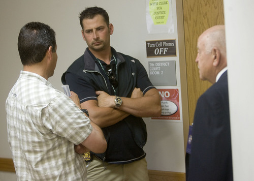 Al Hartmann  |  The Salt Lake Tribune  Defendants charged in the archaelogical looting investigation make their initial  appearance in federal court in Moab Thursday morning.   Mike Wingert with the U.S Marshall Service left, talks with BLM special agent Dan Love outside the courtroom.  Court security officer Del Badham at right.