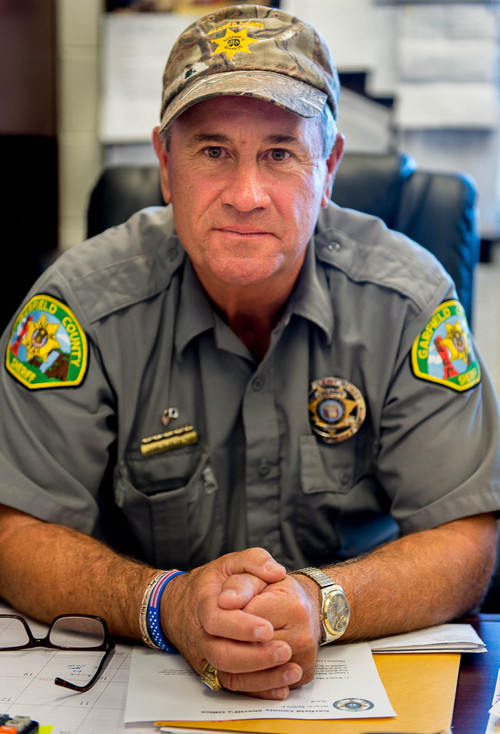 "Trent Nelson  |  The Salt Lake Tribune Garfield County Sheriff James ""Danny"" Perkins is a leading critic of BLM law enforcement. He says the federal agency's officers refuse to recognize the authority of rural sheriffs and coordinate with local law enforcement. Perkins was photographed in his Panguitch office, Friday September 12, 2014."