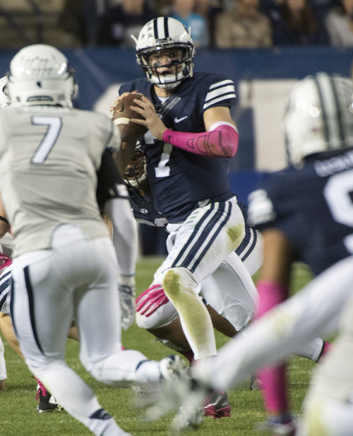 Rick Egan  |  The Salt Lake Tribune  Brigham Young Cougars quarterback Christian Stewart (7) looks for an open man, as he scrambles with the ball, in football action, BYU vs The Nevada Wolf Pack at Lavell Edwards Stadium, Saturday, October18, 2014