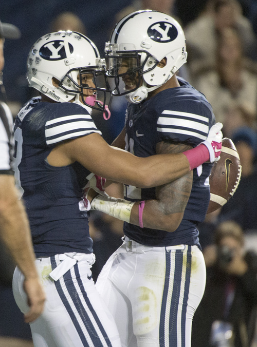 Rick Egan  |  The Salt Lake Tribune  Brigham Young Cougars wide receiver Terenn Houk (11) congratulates Brigham Young Cougars wide receiver Keanu Nelson (18) after Nelson's  fourth-quarter touchdown in football action, BYU vs The Nevada Wolf Pack at LaVell Edwards Stadium, Saturday, October18, 2014