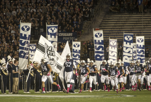 Rick Egan  |  The Salt Lake Tribune  The Cougars take to the field for the late night match-up ,BYU vs The Nevada Wolfpack at Lavell Edwards Stadium, Saturday, October18, 2014