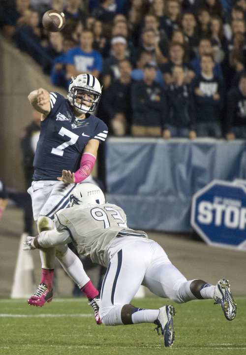 Rick Egan  |  The Salt Lake Tribune  Brigham Young quarterback Christian Stewart (7) throws the ball for the Cougars as he is hit by Nevada Wolf Pack defensive lineman Dupree Roberts-Jordan (93), in football action, BYU vs The Nevada Wolf Pack at LaVell Edwards Stadium, Saturday, October18, 2014.