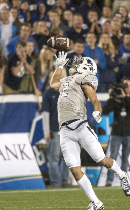 Rick Egan  |  The Salt Lake Tribune  Nevada Wolf Pack wide receiver Richy Turner (2) tips the ball before making a complete catch  in football action, BYU vs The Nevada Wolf Pack at LaVell Edwards Stadium, Saturday, October18, 2014.