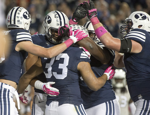 Rick Egan  |  The Salt Lake Tribune  Brigham Young Cougars celebrate the touchdown by running back Paul Lasike (33), in football action, BYU vs The Nevada Wolf Pack at Lavell Edwards Stadium, Saturday, October18, 2014