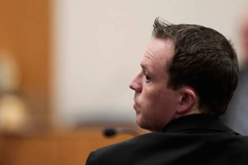 Spencer Heaps | Pool Conrad Truman, left, talks to his defense attorney, Ron