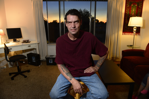 Scott Sommerdorf  |  The Salt Lake Tribune Joseph Hardy in his apartment, Friday, October 10, 2014.  Hardy has spent 14 years in jail and prison and has been an intravenous drug user. He's been clean for over a year and is in permanent assisted housing under Utah's Housing First program.