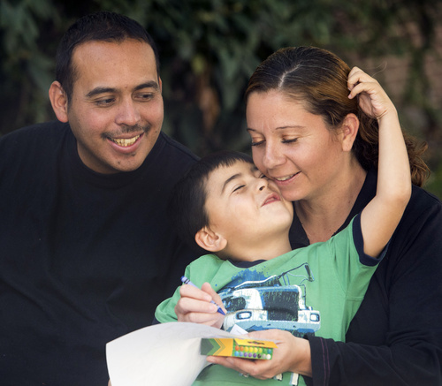 Rick Egan  |  The Salt Lake Tribune  Tony and Cynthia Martinez, with their  4-year-old son, Adrian, at the Road Home shelter, Friday, October 10, 2014