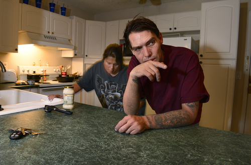 Scott Sommerdorf  |  The Salt Lake Tribune Joseph Hardy talks about his life as he makes dinner with his girlfriend Brandy Gonzalez in his apartment, Friday, October 10, 2014.  Hardy has spent 14 years in jail and prison and has been an intravenous drug user. He's been clean for over a year and is in permanent assisted housing under Utah's Housing First program.
