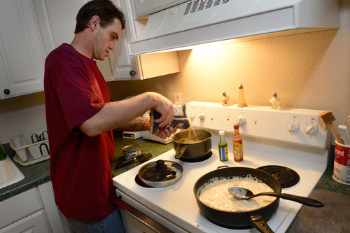 Scott Sommerdorf  |  The Salt Lake Tribune Joseph Hardy makes dinner in his apartment, Friday, October 10, 2014.  Hardy has spent 14 years in jail and prison and has been an intravenous drug user. He's been clean for over a year and is in permanent assisted housing under Utah's Housing First program.