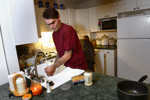 Scott Sommerdorf  |  The Salt Lake Tribune Joseph Hardy makes dinner with his girlfriend Brandy Gonzalez in his apartment, Friday, October 10, 2014.  Hardy has spent 14 years in jail and prison and has been an intravenous drug user. He's been clean for over a year and is in permanent assisted housing under Utah's Housing First program.