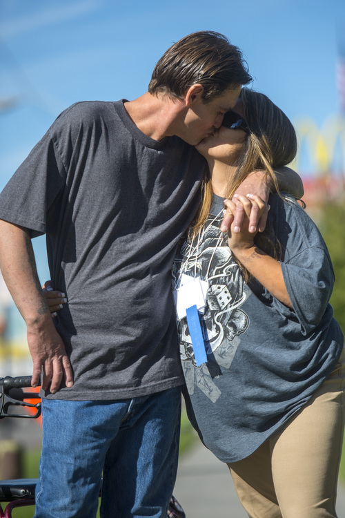 Chris Detrick  |  The Salt Lake Tribune Joseph Hardy kisses his girlfriend Brandy Gonzalez Wednesday October 8, 2014.  Hardy who was homeless but now is in a program called Housing First, aimed at getting people into housing before counseling and job seeking.