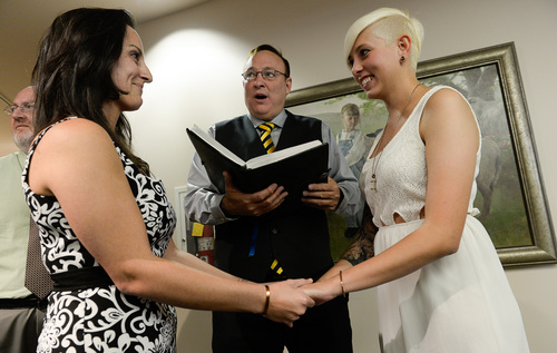 Francisco Kjolseth  |  The Salt Lake Tribune Senator Jim Dabakis marries Yolanda Pascua, left, and Laekin Rogers on Monday at the Salt Lake County Complex. The U.S. Supreme Court declined to review all five pending same-sex marriage cases on Monday, Oct. 6, 2014 effectively legalizing gay and lesbian unions, clearing the way for such marriages to proceed in 11 new states - including Utah.
