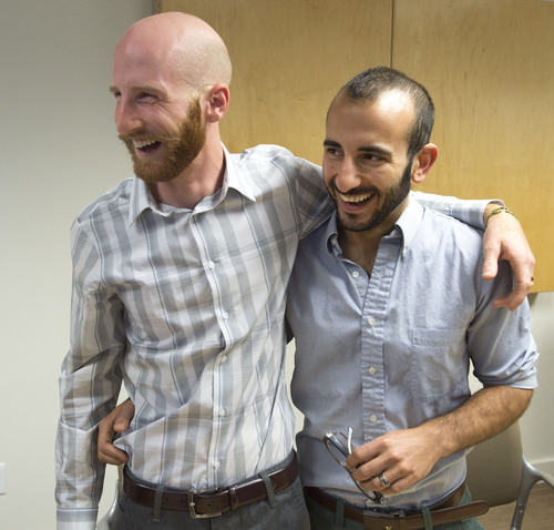 Steve Griffin  |  The Salt Lake Tribune  Derek Kitchen, left, hugs his partner, Moudi Sbeity, following a press conference at Magleby and Greenwood law offices in Salt Lake City, Monday, October 6, 2014.
