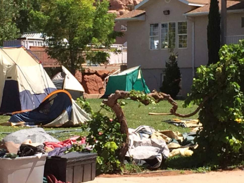 D.J. Bolerjack  |  KUTV  Tents sit outside a home on Homestead Street in Hildale on Aug. 1, 2014. People in the tents appear to be residents recently served eviction notices for failure to pay taxes and a $100 a month occupancy fee to the United Effort Plan.