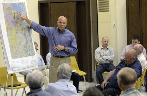 Al Hartmann  |  The Salt Lake Tribune Lt. Col. Chris Robinson, a U.S. Air Force representative, discusses a map of expansion of the Utah Test and Training Range during a presentation at a public forum Monday Oct. 20, 2014, at West Desert High School in Partoun.