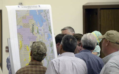 Al Hartmann  |  The Salt Lake Tribune The purple boxes in this map of western Utah delineate the proposed expansion of the Utah Test and Training Range. Residents of western Juab County listen to a U.S. Air Force representative's presentation at a public forum Monday Oct. 20, 2014, at West Desert High School in Partoun to discuss expanding the Utah Test and Training Range.