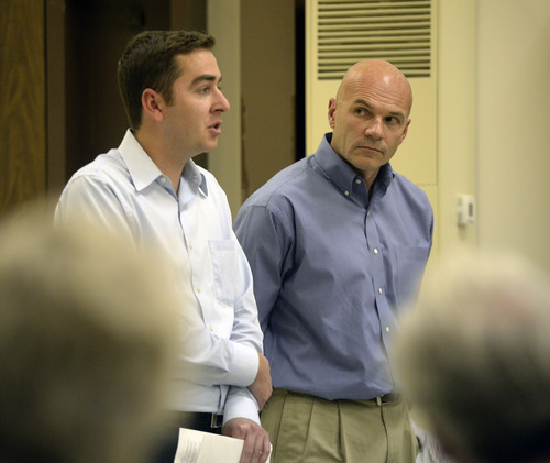 Al Hartmann  |  The Salt Lake Tribune Ed Cox, a representative from Sen. Orrin Hatch's office, left, and Lt. Col. Chris Robinson answer questions during a public forum Monday Oct. 20, 2014, at West Desert High School in Partoun on expanding the Utah Test and Training Range.