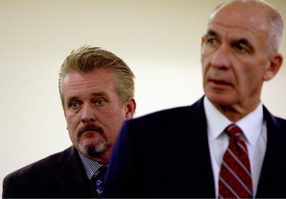 (Geoff Liesik     Pool)  Myton Police Chief Thomas Wade Butterfield, left, makes his initial appearance with defense attorney Earl Xaiz in 8th District Court on Monday, Oct. 20, 2014. Butterfield is charged with three counts of stalking, one count of unlawful detention and one count of criminal trespass. The charges are all misdemeanors.