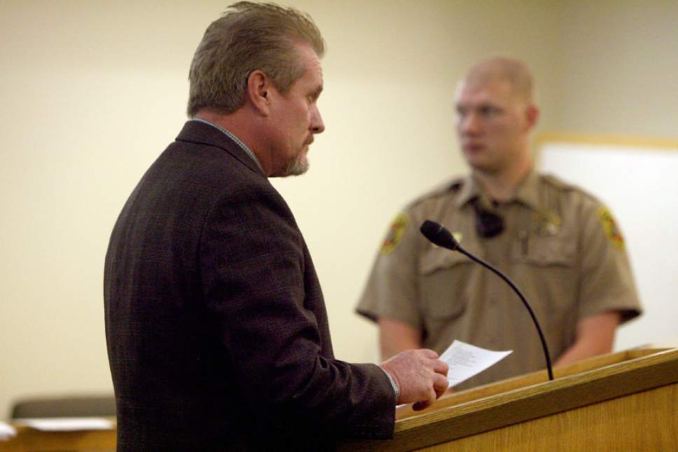 (Geoff Liesik  |  Pool)  Myton Police Chief Thomas Wade Butterfield, left, makes his initial appearance in 8th District Court on Monday, Oct. 20, 2014. Butterfield is charged with three counts of stalking, one count of unlawful detention and one count of criminal trespass. The charges are all misdemeanors.