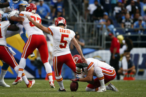 Kansas City Chiefs kicker Cairo Santos kicks a field goal against the San Diego Chargers during the second half of an NFL football game Sunday, Oct. 19, 2014, in San Diego. (AP Photo/Lenny Ignelzi)