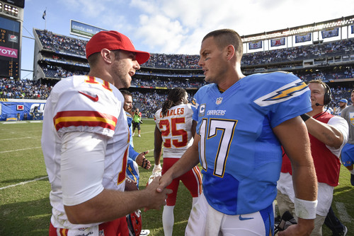 Kansas City Chiefs quarterback Alex Smith (11), left, shakes hands with San Diego Chargers quarterback Philip Rivers (17) after an NFL football game Sunday, Oct. 19, 2014, in San Diego. The Chiefs won 23-20. (AP Photo/Denis Poroy)