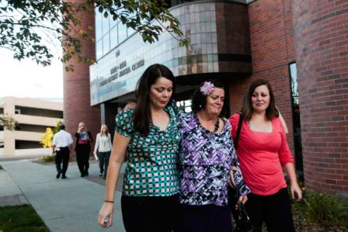Spenser Heaps  |  Pool   Heidy Truman's mother Janet Wagner, center, and sisters Autumn Wagner, left, and Amanda Wagner, right, walk out of 4th District Court in Provo after the jury found Heidy's husband Conrad Truman guilty of murder and obstruction of justice in her 2012 shooting death on Wednesday, Oct. 22, 2014.