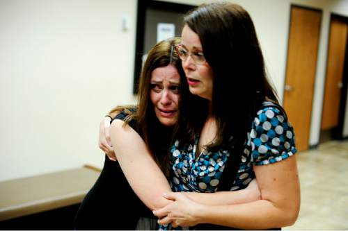 Ian Maule  |  Pool   Sommer Keller, left, and Autumn Wagner, both sisters of Heidy Truman, react after their sister's husband, Conrad Truman, was found guilty of murder and obstruction of justice in Heidy's 2012 death at 4th District Court in Provo on Wednesday, Oct. 22, 2014.