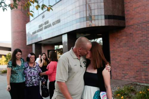 Spenser Heaps  |  Pool   Sommer Keller, right, sister of Heidy Truman, embraces her husband Jason Keller, as they leave 4th District Court in Provo after Heidy's husband Conrad Truman was found guilty of murder and obstruction of justice in Heidy's 2012 death on Wednesday, Oct. 22, 2014. Heidy Truman's mother Janet Wagner, second from left, walks with Heidy's sisters Autumn Wagner, left, and Amanda Wagner.
