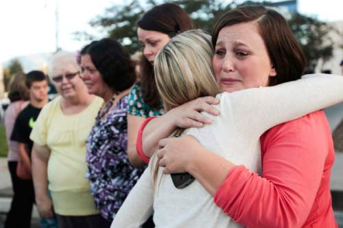 Spenser Heaps  |  Pool   Amanda Wagner, sister of Heidy Truman, hugs a police victim's advocate outside 4th District Court in Provo on Wednesday, Oct. 22, 2014 after a jury found Conrad Truman guilty of murder and obstruction of justice in the 2012 death of his wife Heidy Truman.
