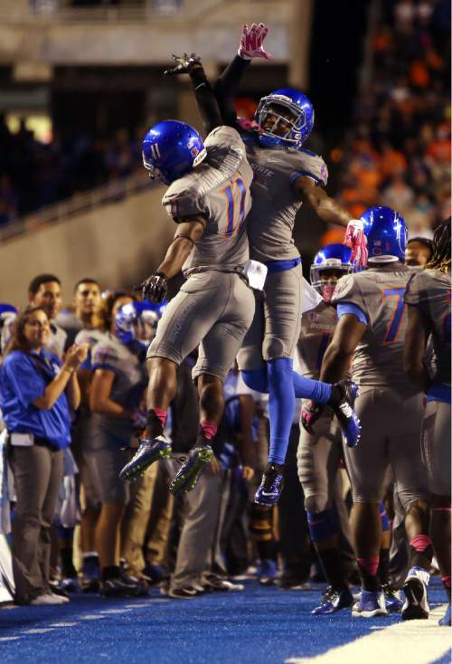 Boise State wide receiver Shane Williams-Rhodes (11) celebrates his first-half touchdown with wide receiver Chaz Anderson (6) during an NCAA college football game against BYU in Boise, Idaho, Friday, Oct. 24, 2014. (AP Photo/The Idaho Statesman, Kyle Green) MANDATORY CREDIT; LOCAL TELEVISION OUT (KTVB 7)