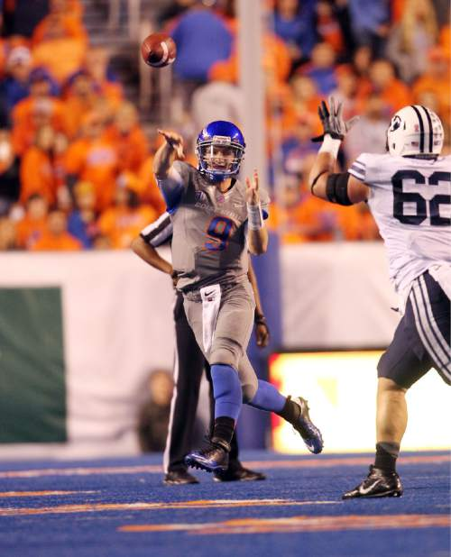 Boise State quarterback Grant Hedrick (9) looks for a receiver downfield against BYU during an NCAA college football game in Boise, Idaho, Friday, Oct. 24, 2014. (AP Photo/The Idaho Statesman, Kyle Green) MANDATORY CREDIT; LOCAL TELEVISION OUT (KTVB 7)