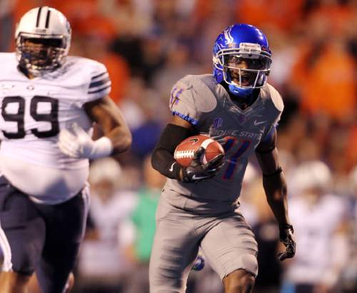 Boise State wide receiver Shane Williams-Rhodes sprints for a first-half touchdown against BYU during an NCAA college football game in Boise, Idaho, Friday, Oct. 24, 2014. (AP Photo/The Idaho Statesman, Kyle Green) MANDATORY CREDIT; LOCAL TELEVISION OUT (KTVB 7)